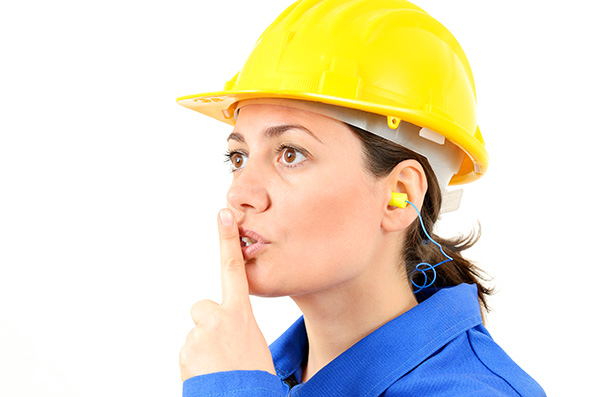 Woman in Hardhat and Earplugs