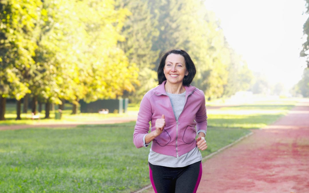 Middle-aged-woman-happy-joggin-through-park-1080x675.jpeg