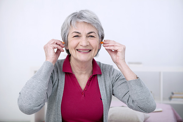 Elderly Woman with Earplugs