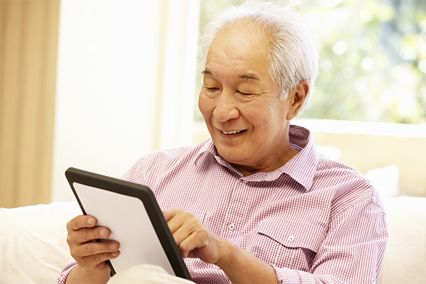 Elderly Man on Tablet