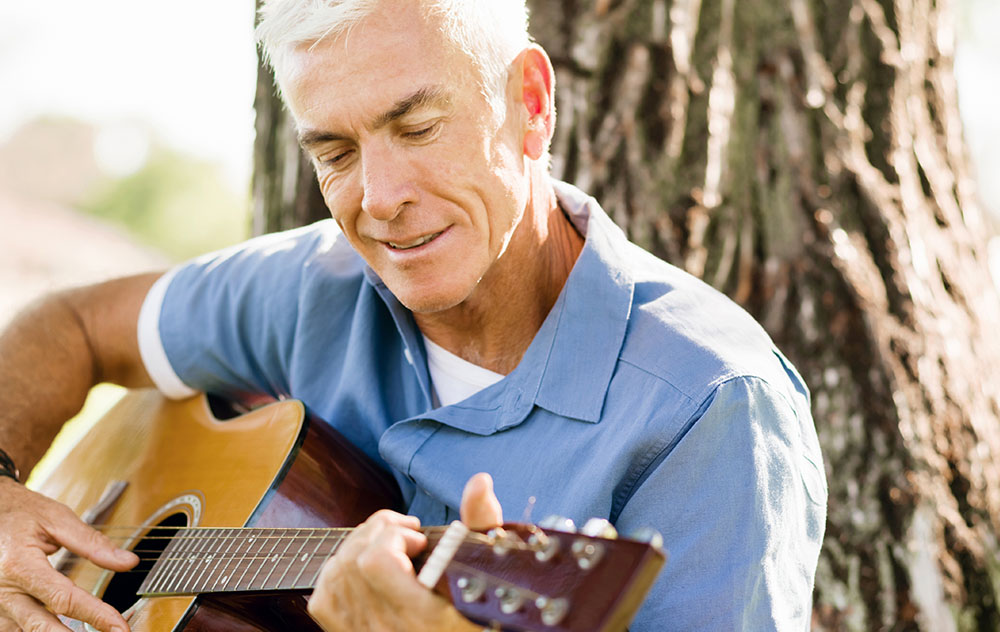 Elderly Man with Guitar