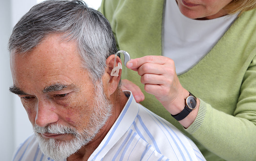 Man with Hearing Aid and Earmold