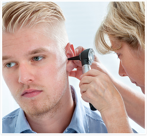 audiologist checking a patient's ears in Bowie, MD